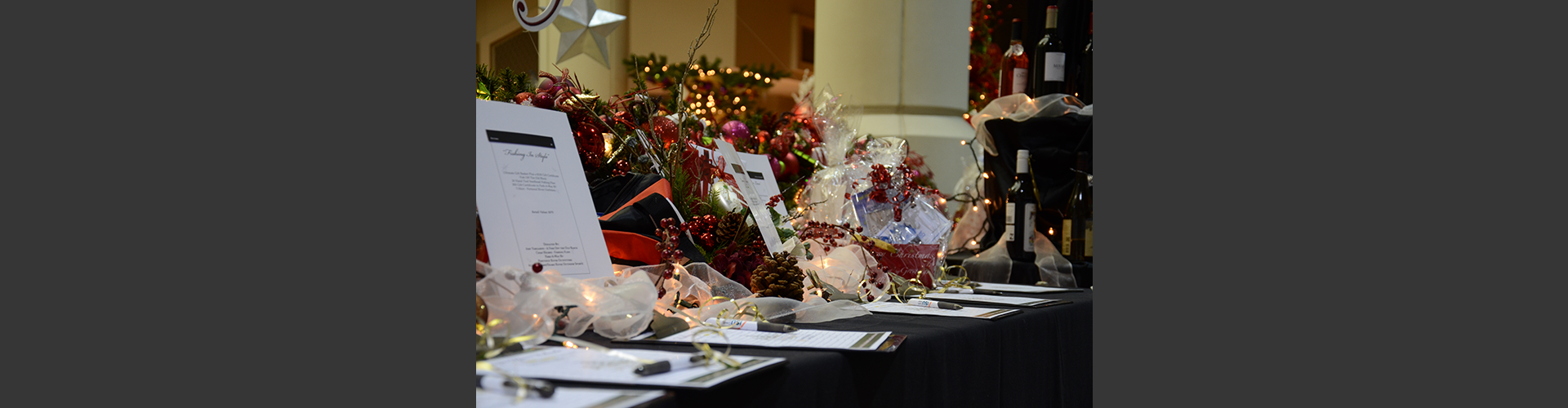 image of opening gala silent auction items at the Festival of Trees